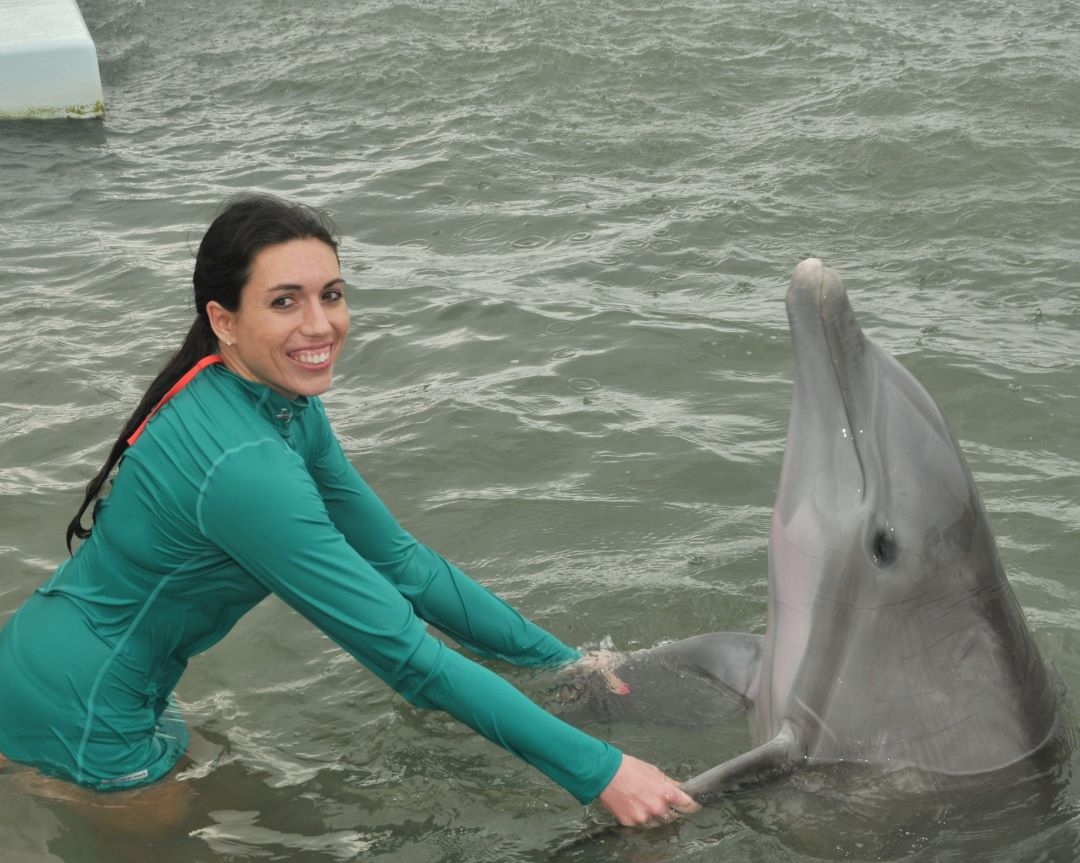 Becky Conti Swimming with Dolphins